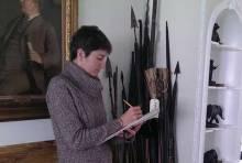 Artist Alison Nicholls sketching in the Roosevelt Room.